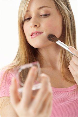 Girl Applying Make-Up Stock Photo - Premium Royalty-Free, Code: 600-00866228