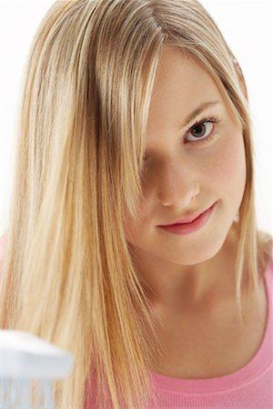 Girl Brushing Hair Stock Photo - Premium Royalty-Free, Code: 600-00866220