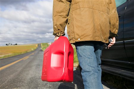 stalled car - Man Carrying Gas Can Stock Photo - Premium Royalty-Free, Code: 600-00866957