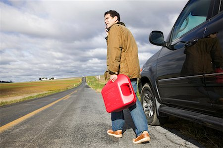 stalled car - Man Carrying Gas Can on Country Road Stock Photo - Premium Royalty-Free, Code: 600-00866958