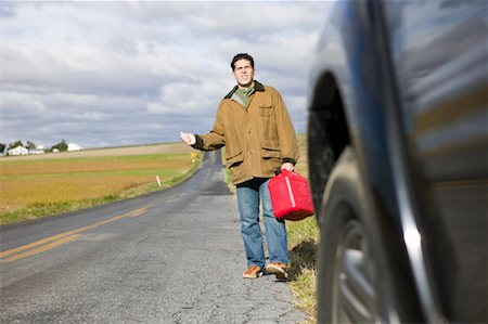 stalled car - Man With Gas Can, Trying To Hitch a Ride Stock Photo - Premium Royalty-Free, Code: 600-00866959