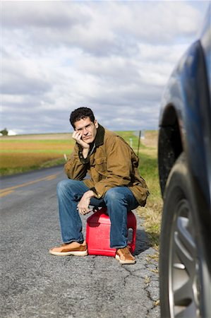 stalled car - Man Sitting on Gas Can Stock Photo - Premium Royalty-Free, Code: 600-00866960