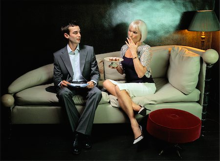 Couple Sitting on Sofa Stock Photo - Premium Royalty-Free, Code: 600-00909836