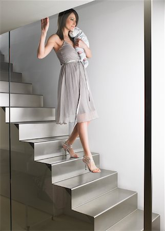 Mother Carrying Baby Down Stairs Stock Photo - Premium Royalty-Free, Code: 600-00917267