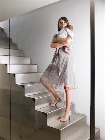 Mother Standing on Stairs with Baby Stock Photo - Premium Royalty-Free, Code: 600-00917269