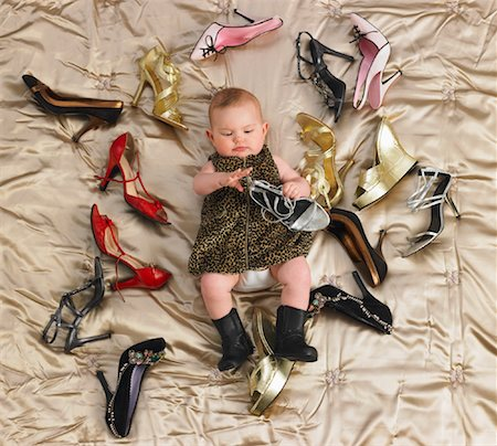 Baby Surrounded by Shoes Stock Photo - Premium Royalty-Free, Code: 600-00917278