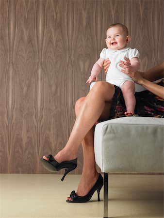 Baby Sitting on Mother's Lap Stock Photo - Premium Royalty-Free, Code: 600-00917272