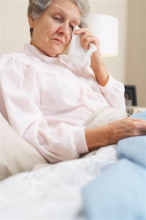 sleepy old woman - Portrait of Woman in Bed Stock Photo - Premium Royalty-Free, Code: 600-00917409