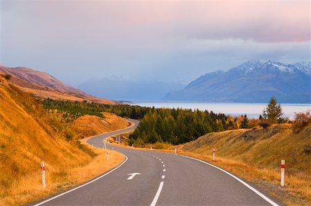 road landscape - Road by Lake and Mountain, Lake Pukaki, Canterbury, South Island, New Zealand Stock Photo - Premium Royalty-Free, Code: 600-00917948