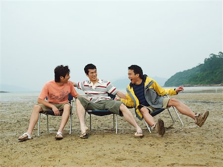 Men Goofing Around on the Beach Stock Photo - Premium Royalty-Free, Code: 600-00910405