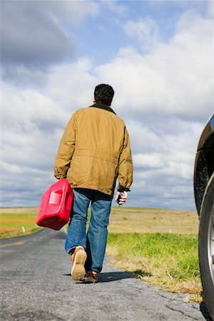 stalled car - Man Walking on Road, Carrying Gas Can Stock Photo - Premium Royalty-Free, Code: 600-00910769