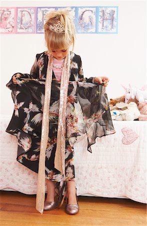 Girl Wearing Woman's Dress Stock Photo - Premium Royalty-Free, Code: 600-00934201