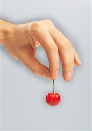 Person's Hands Holding Cherry Stock Photo - Premium Royalty-Free, Code: 600-00934703