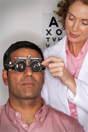 Doctor Performing Eye Test Stock Photo - Premium Royalty-Free, Code: 600-00935089