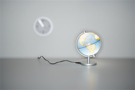 Illuminated Globe and Wall Clock Stock Photo - Premium Royalty-Free, Code: 600-00933866