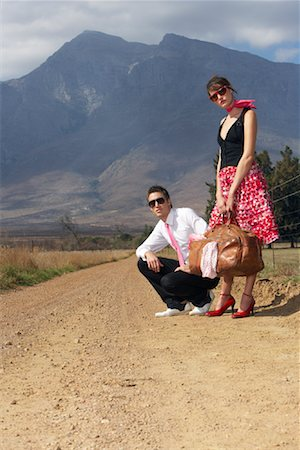 A Young Couple Hitchhiking Stock Photo - Premium Royalty-Free, Code: 600-00948065