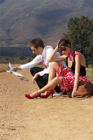 Couple Stranded On Country Road Stock Photo - Premium Royalty-Free, Code: 600-00948071