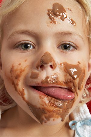 Girl with Chocolate on Face Stock Photo - Premium Royalty-Free, Code: 600-00948150