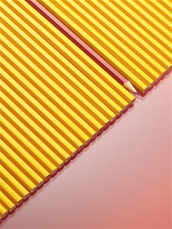Row of Yellow Pencils With One Red Pencil Stock Photo - Premium Royalty-Free, Code: 600-00948659