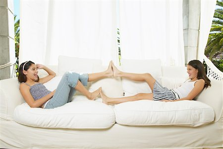 Girls Playing on Couch Stock Photo - Premium Royalty-Free, Code: 600-00954254