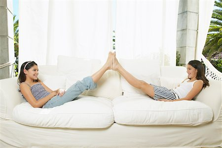 preteen girl feet - Girls Playing on Couch Stock Photo - Premium Royalty-Free, Code: 600-00954255
