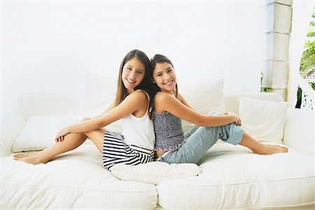 preteen girl feet - Girls Sitting on Couch Stock Photo - Premium Royalty-Free, Code: 600-00954258