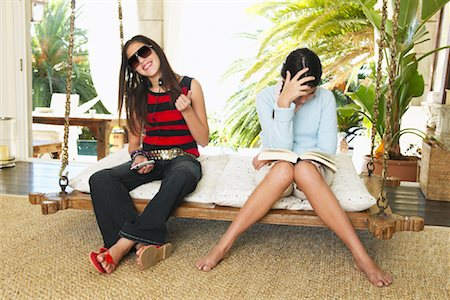 preteen girl feet - Sisters Sitting on Porch Swing Stock Photo - Premium Royalty-Free, Code: 600-00954251
