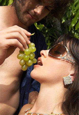 Man Feeding Woman Grapes Stock Photo - Premium Royalty-Free, Code: 600-00954382