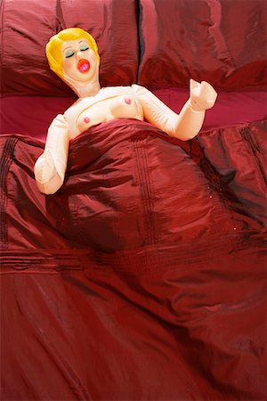 Blow-Up Doll in Bed Stock Photo - Premium Royalty-Free, Code: 600-00954709