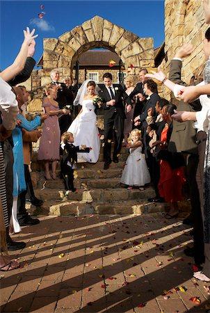 Newlyweds Leaving Church Stock Photo - Premium Royalty-Free, Code: 600-00955437