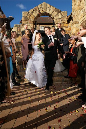 Newlyweds Leaving Church Stock Photo - Premium Royalty-Free, Code: 600-00955438