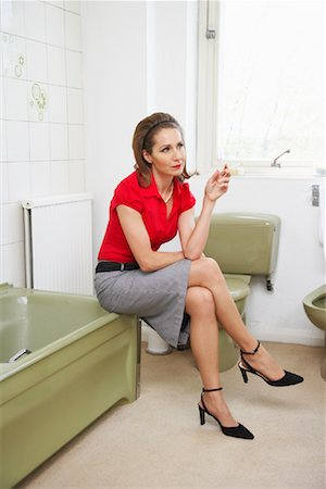 Woman Smoking in Bathroom Stock Photo - Premium Royalty-Free, Code: 600-00984211