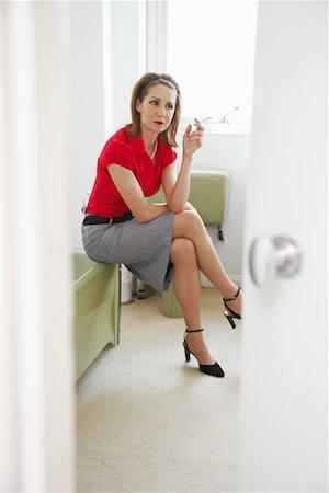 Woman Smoking in Bathroom Stock Photo - Premium Royalty-Free, Code: 600-00984212