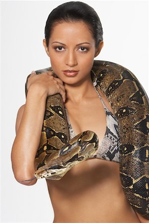 sexually aroused woman - Portrait of Woman with Boa Constrictor Wrapped Around Neck Stock Photo - Premium Royalty-Free, Code: 600-00984429