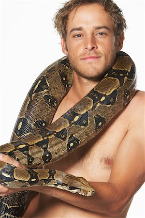 Portrait of Man with Boa Constrictor Stock Photo - Premium Royalty-Free, Code: 600-00984431