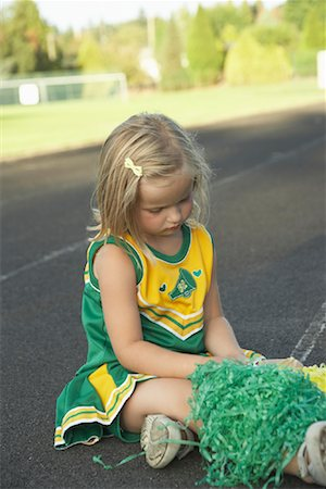 Girl Dressed as Cheerleader Stock Photo - Premium Royalty-Free, Code: 600-01015105