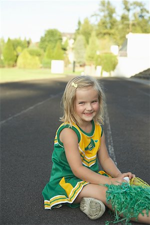 Girl Dressed as Cheerleader Stock Photo - Premium Royalty-Free, Code: 600-01015106