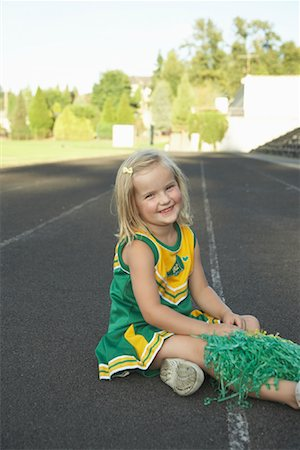 Girl Dressed as Cheerleader Stock Photo - Premium Royalty-Free, Code: 600-01015107