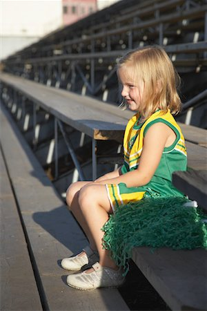 Girl Dressed as Cheerleader in Bleachers Stock Photo - Premium Royalty-Free, Code: 600-01015109