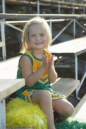 Girl Dressed as Cheerleader in Bleachers Stock Photo - Premium Royalty-Free, Code: 600-01015110