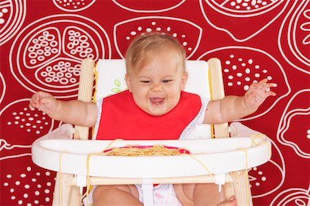 Baby with Spaghetti in High Chair Stock Photo - Premium Royalty-Free, Code: 600-01015390