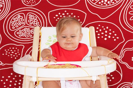 Baby with Spaghetti in High Chair Stock Photo - Premium Royalty-Free, Code: 600-01015391
