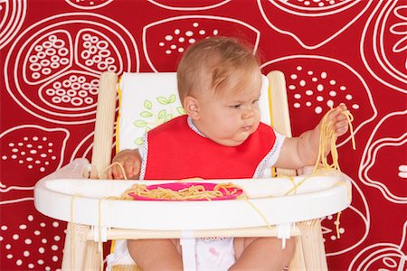 Baby with Spaghetti in High Chair Stock Photo - Premium Royalty-Free, Code: 600-01015392