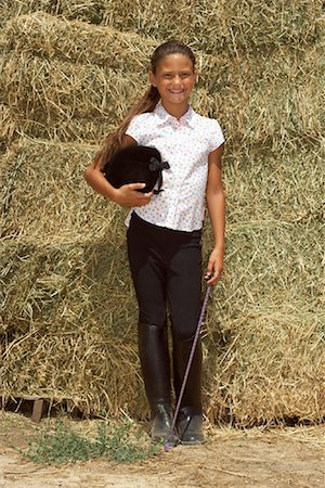 Young girls in riding boots Stock Photos - Page 1 : Masterfile
