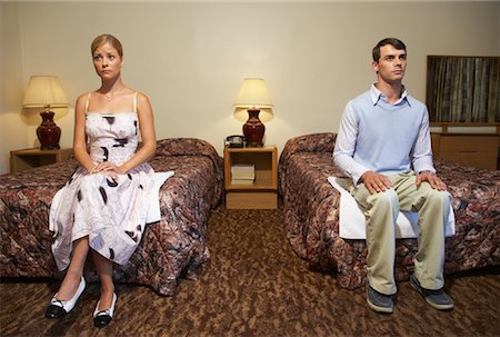 sad lovers break up - Nervous Couple in Motel Room Stock Photo - Premium Royalty-Free, Code: 600-01041462