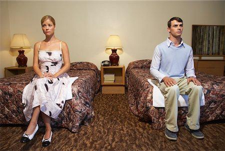 sad lovers break up - Nervous Couple in Motel Room Stock Photo - Premium Royalty-Free, Code: 600-01041462