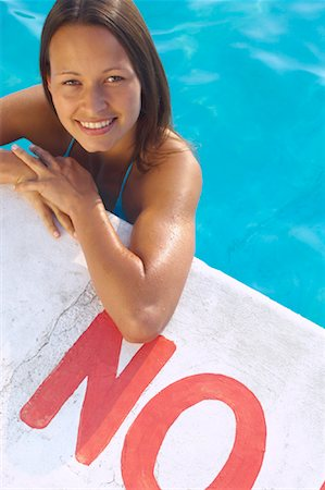Woman in Swimming Pool Stock Photo - Premium Royalty-Free, Code: 600-01041627