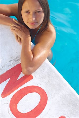 Woman in Swimming Pool Stock Photo - Premium Royalty-Free, Code: 600-01041628
