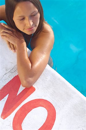 Woman in Swimming Pool Stock Photo - Premium Royalty-Free, Code: 600-01041629