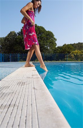 Woman at Side of Swimming Pool Stock Photo - Premium Royalty-Free, Code: 600-01041645